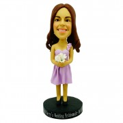 Dressed in sun-top wedding dress with a bundle of  flowers in her hand bridesmaid custom bobblehead