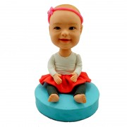 Sitting down smiling happily custom kids bobblehead