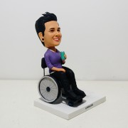 one person sitting on wheelchair bobble heads