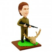 Having a deer head on the ground with a gun custom hunter bobblehead