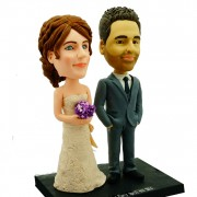 Handsome groom hand in hand with fair bride holding a bunch of flowers custom bobblehead
